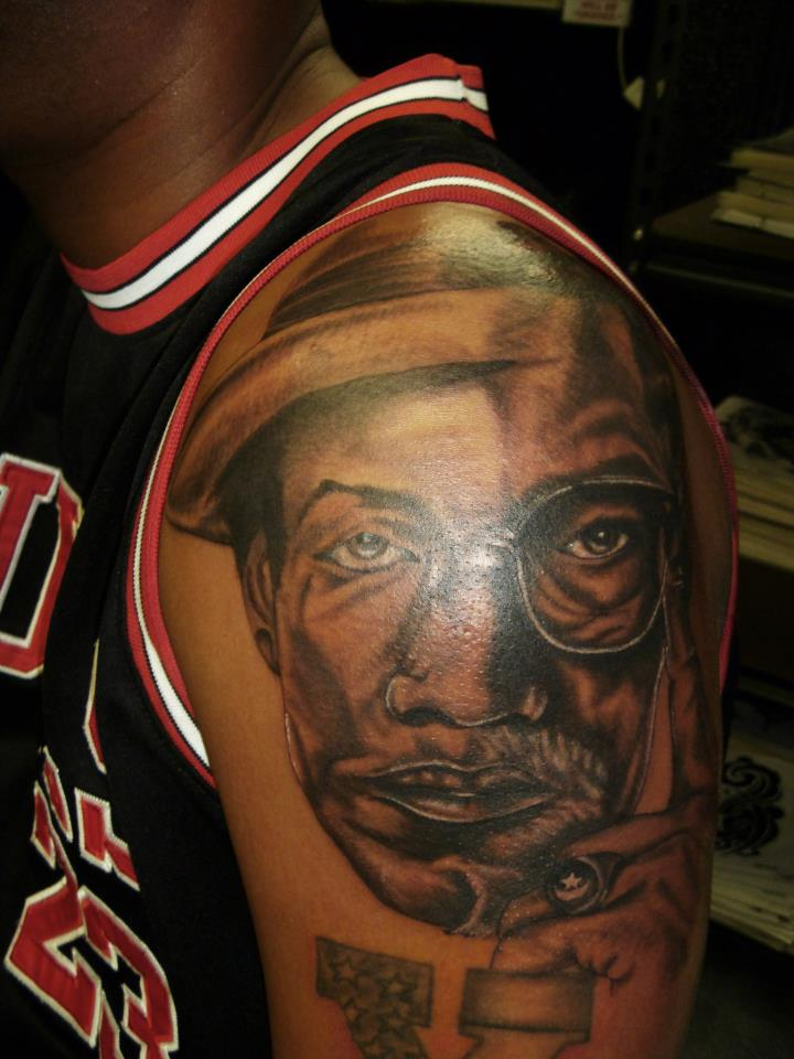 Southern blues tattoos piercings www facebook com for Nas malcolm x tattoo